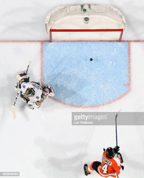 Sean Couturier of the Philadelphia Flyers shoots the puck into the empty net against MarcAndry Fleury of the Vegas Golden Knights on March 12 2018 at...