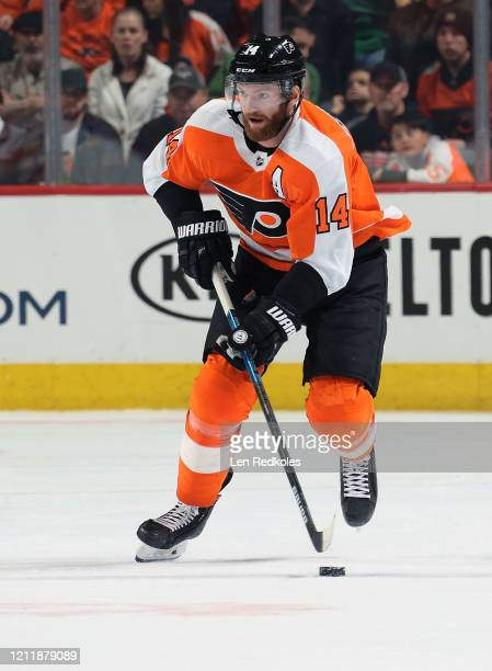 Sean Couturier of the Philadelphia Flyers skates the puck against the Carolina Hurricanes on March 5, 2020 at the Wells Fargo Center in Philadelphia,...