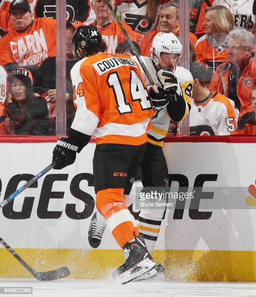 Sean Couturier of the Philadelphia Flyers steps into Sidney Crosby of the Pittsburgh Penguins during the first period in Game Three of the Eastern...