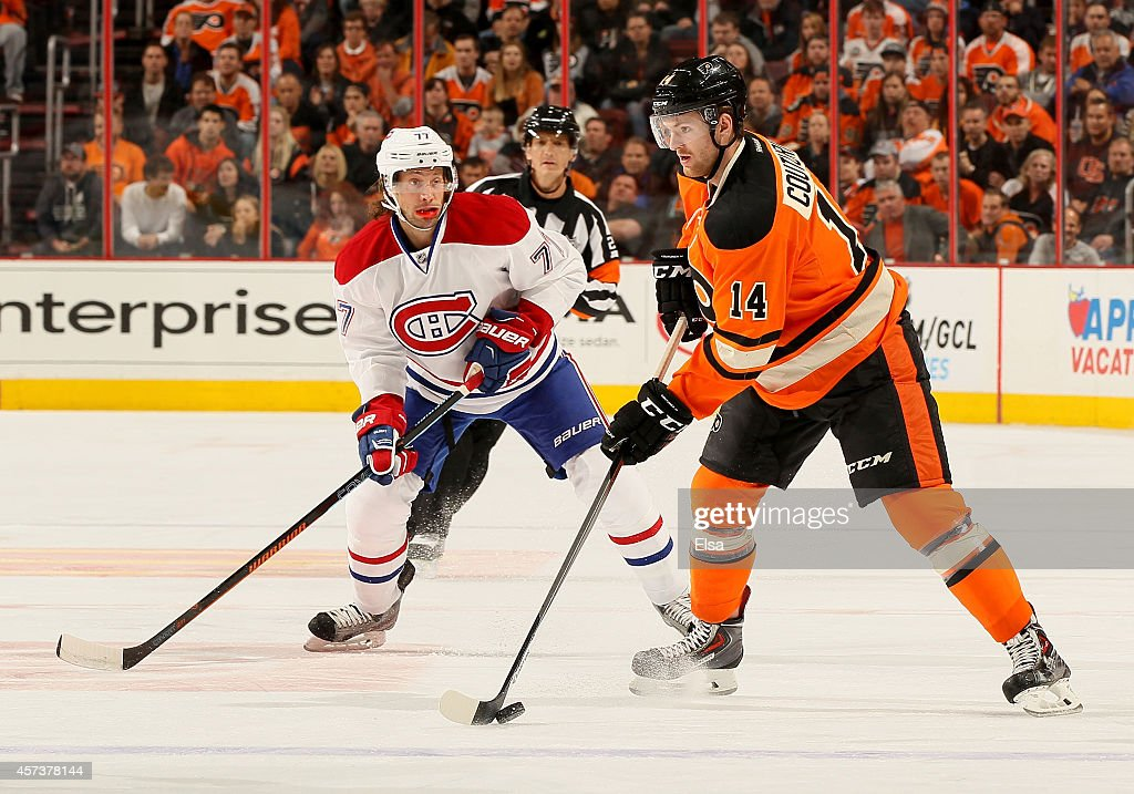 Sean Couturier #14 of the Philadelphia Flyers takes the puck as Tom Gilbert #77 of the Montreal Canadiens defends on October 11, 2014 at the Wells Fargo Center in Philadelphia, Pennsylvania.