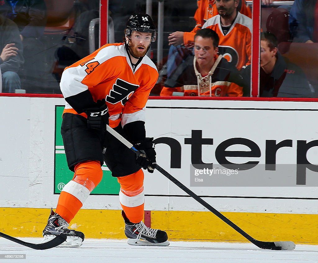 Sean Couturier #14 of the Philadelphia Flyers takes the puck in the third period against the New York Islanders on April 7, 2015 at the Wells Fargo Center in Philadelphia, Pennsylvania.The Philadelphia Flyers defeated the New York Islanders 5-4.