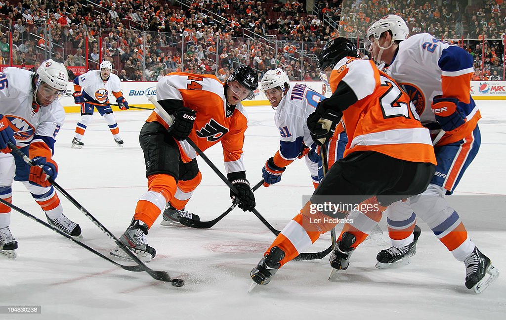 Sean Couturier #14 of the Philadelphia Flyers wins a faceoff into the corner from John Tavares #91 of the New York Islanders on March 28, 2013 at the Wells Fargo Center in Philadelphia, Pennsylvania.