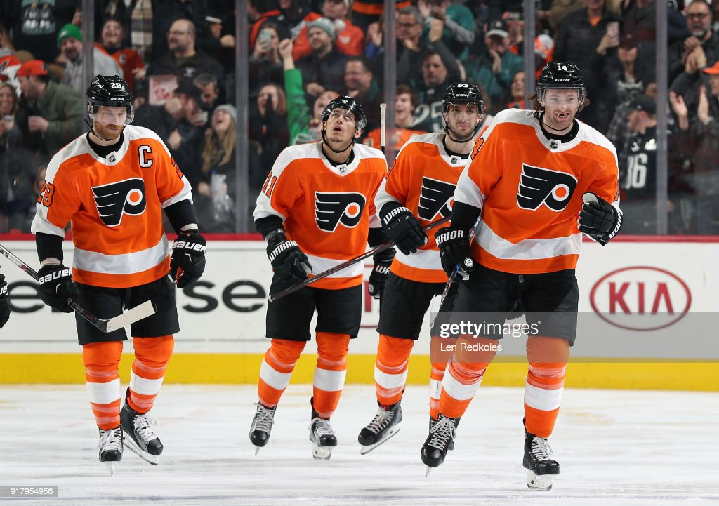 Sean Couturier #14, Shayne Gostisbehere #53, Travis Konecny #11 and Claude Giroux #28 of the Philadelphia Flyers reacts following a third period goal against the Montreal Canadiens on February 8, 2018 at the Wells Fargo Center in Philadelphia, Pennsylvania.
