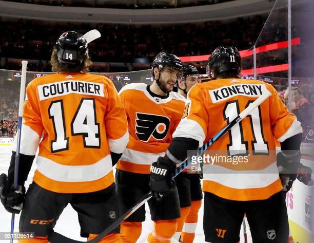 Sean CouturierValtteri Filppula and Travis Konecny of the Philadelphia Flyers congratulate teammate Claude Giroux after he scored in the second...