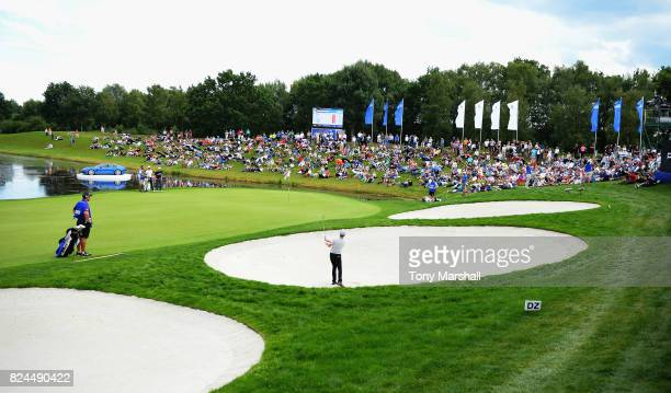 Sean Crocker of the United States plays out of a bunker on the 18th green during the Porsche European Open Day Four at Green Eagle Golf Course on...