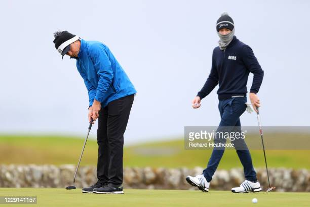 Sean Crocker of the United States watches Eddie Pepperell of Englanda putt on the 3rd green during Day Four of the Scottish Championship presented by...