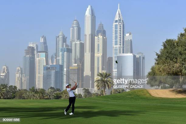 TOPSHOT Sean Crocker of US takes a shot during the round one of the Dubai Desert Classic Golf Championship at the Emirates Golf Club in Dubai on...