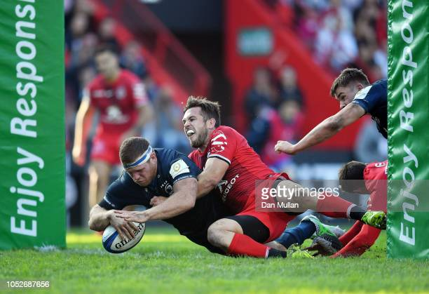 Sean Cronin of Leinster dives over to score his side's third try during the Champions Cup match between Toulouse and Leinster Rugby at Stade...