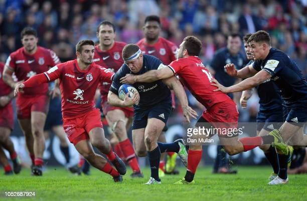 Sean Cronin of Leinster makes a break past Zack Holmes of Toulouse to score his side's third try during the Champions Cup match between Toulouse and...