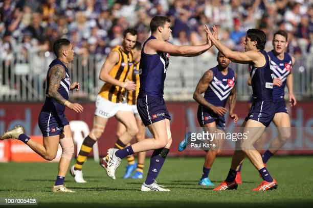Sean Darcy and Adam Cerra of the Dockers celebrate a goal during the round 19 AFL match between the Fremantle Dockers and the Hawthorn Hawks at Optus...