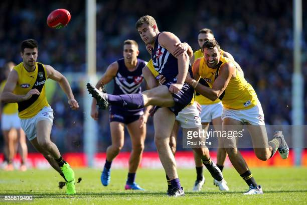 Sean Darcy of the Dockers gets his kick away during the round 22 AFL match between the Fremantle Dockers and the Richmond Tigers at Domain Stadium on...