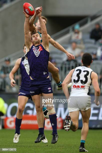Sean Darcy of the Dockers sets for a mark during the round 17 AFL match between the Fremantle Dockers and the Port Adelaide Power at Optus Stadium on...