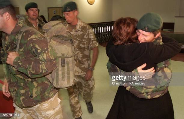 Sean Darnell from Weymouth a member of Bravo Company 40 Commando Royal Marines is greeted on his return home to Exeter Airport in Devon 40 Commando...