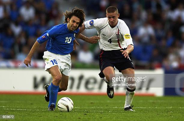 Sean Davis of England closes down Andrea Pirlo of Italy during the 2002 UEFA U21 Championship match between England and Italy held at the St Jakob...