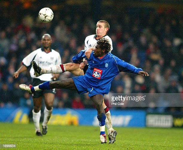 Sean Davis of Fulham tussles with Aliou Cisse of Birmingham City for possession of the ball during the FA Barclaycard Premiership match between...
