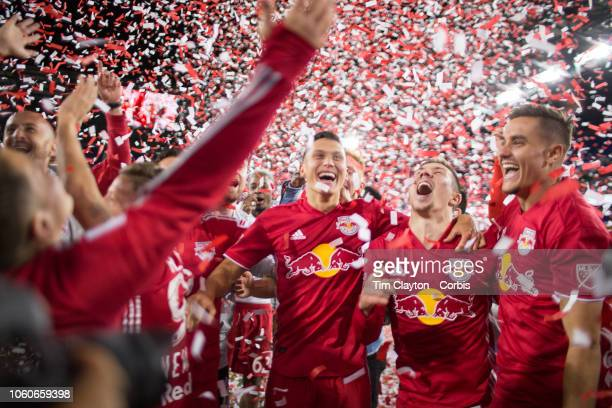 Sean Davis of New York Red Bulls Alex Muyl of New York Red Bulls and Aaron Long of New York Red Bulls celebrate with tame mates after the team won...
