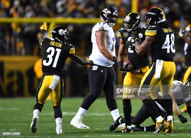 Sean Davis of the Pittsburgh Steelers celebrates with teammates after incepting a pass thrown by Joe Flacco of the Baltimore Ravens in the first...