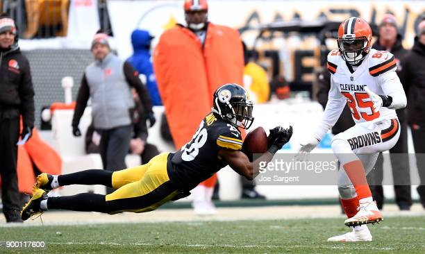 Sean Davis of the Pittsburgh Steelers intercepts a pass in front of David Njoku of the Cleveland Browns in the second half during the game at Heinz...