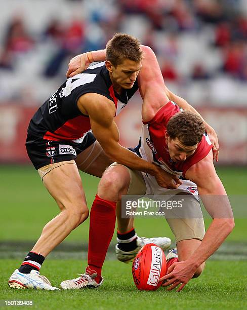 Sean Dempster of the Saints and Jake Spencer of the Demons contest the ball during the round 20 AFL match between the St Kilda Saints and the...