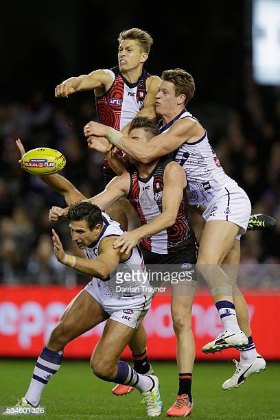 Sean Dempster of the Saints spoils the ball over team mate Sam Fisher and Matthew Pavlich of the Dockers during the round 10 AFL match between the St...