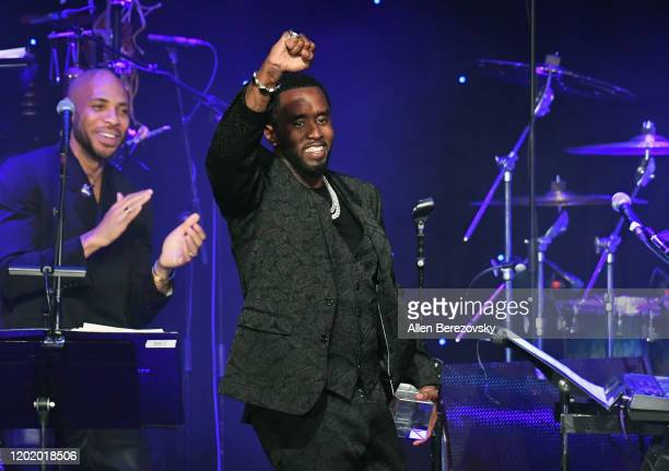 """Sean """"Diddy"""" Combs accepts the President's Merit Award onstage during the Pre-GRAMMY Gala and GRAMMY Salute to Industry Icons Honoring Sean """"Diddy""""..."""
