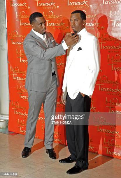 Sean Diddy Combs adjusts the bow tie on his wax likeness unveiled December 15 2009 at Madame Tussauds New York wax museum AFP PHOTO/Stan Honda