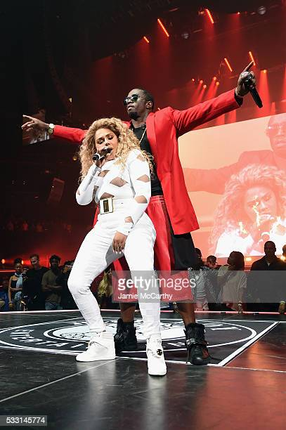 Sean 'Diddy' Combs aka Puff Daddy and Lil Kim perform onstage during the Puff Daddy and The Family Bad Boy Reunion Tour presented by Ciroc Vodka And...