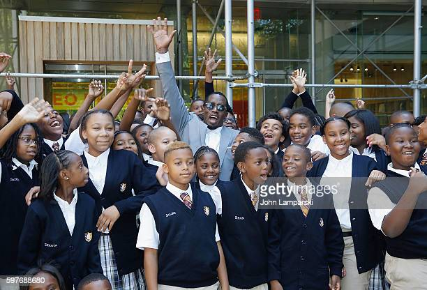 "Sean ""Diddy"" Combs and children from Capital Prep Harlem Charter School attend the Sean ""Diddy"" Combs Charter School opening at Capital Preparatory..."