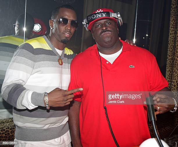 """Sean """"Diddy"""" Combs and Funkmaster Flex attend Funkmaster Flex's birthday party at M2 Ultra Lounge on August 6, 2009 in New York City."""