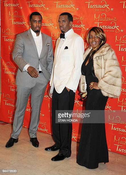 Sean Diddy Combs and his mother Janice Combs pose with a wax figure in his likeness unveiled on December 15 2009 at Madame Tussauds New York wax...