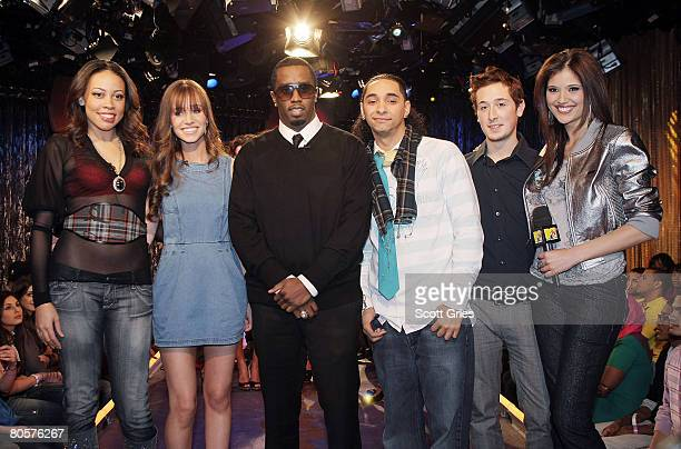 Sean Diddy Combs and host Lyndsey Rodrigues pose for a photo with student designers onstage during a Sean Jean internship competition at the MTV...