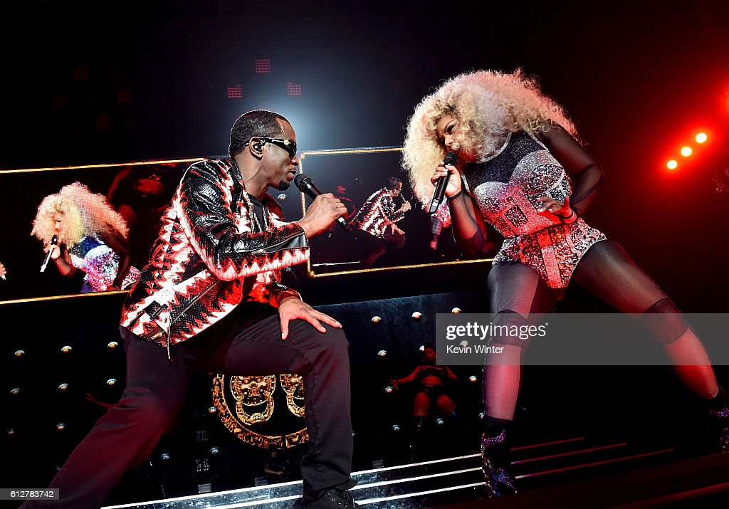 Sean 'Diddy' Combs (L) and Lil' Kim perform onstage during the Bad Boy Family Reunion Tour at The Forum on October 4, 2016 in Inglewood, California.