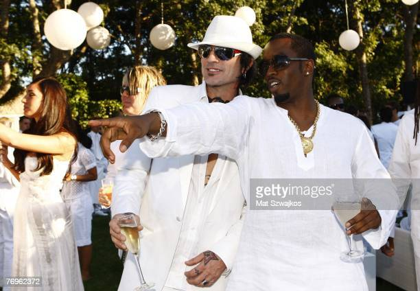 """Sean """"Diddy"""" Combs and musician Tommy Lee attend """"The Real White Party"""" presented by Sean """"Diddy"""" Combs at the Combs' East Hampton estate on..."""