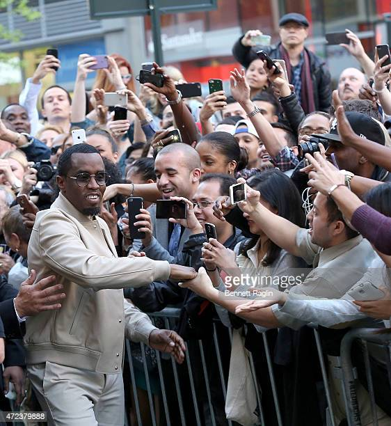 Sean Diddy Combs greets fan during the 3am Fragrance Launch at Macy's Herald Square on May 6 2015 in New York City