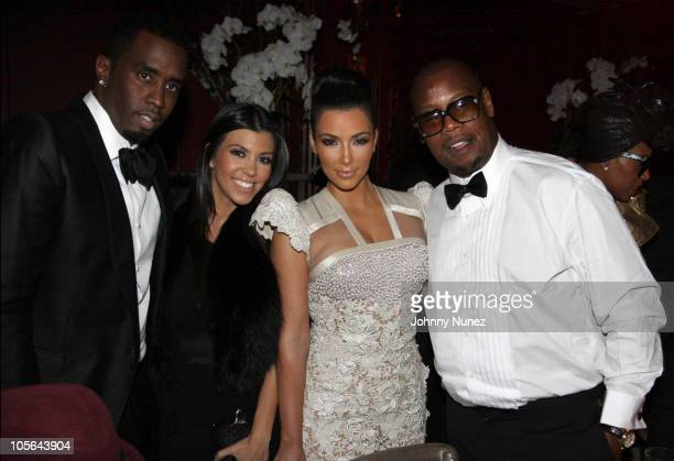 Sean Diddy Combs Kourtney Kardashian Kim Kardashian and Andre Harrell attend Andre Harrell's 50th birthday party at The Darby restaurant on October...