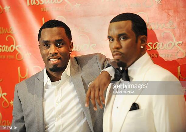 Sean Diddy Combs poses with a wax figure in his likeness unveiled December 15 2009 at Madame Tussauds New York wax museum AFP PHOTO/Stan Honda