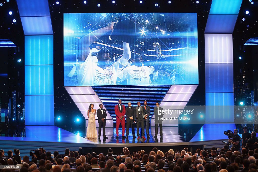 Sean 'Diddy' Combs presents Best Team award to winners NBA player LeBron James, NBA coaches David Fizdale and Erik Spoelstra along with NBA players Ray Allen and Dwyane Wade onstage at The 2013 ESPY Awards at Nokia Theatre L.A. Live on July 17, 2013 in Los Angeles, California.