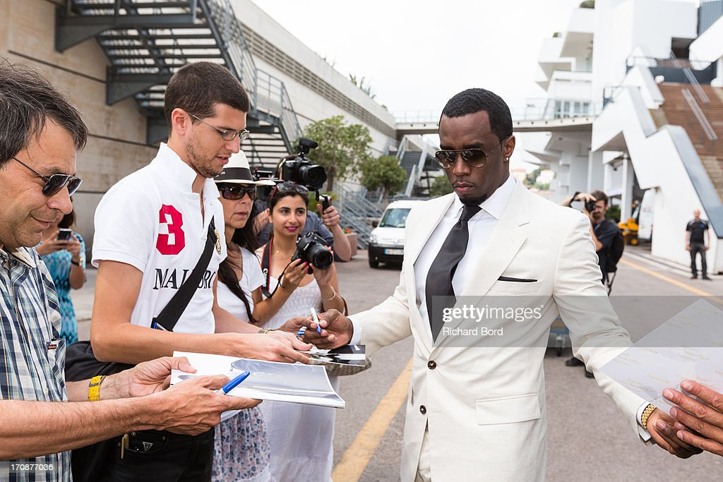 Sean 'Diddy' Combs signs autographs to fans at the Palais des Festivals as he attends the 'Culture as a Creative Catalyst ' Seminar during the 60th Cannes Lions International Festival of Creativity on June 19, 2013 in Cannes, France.