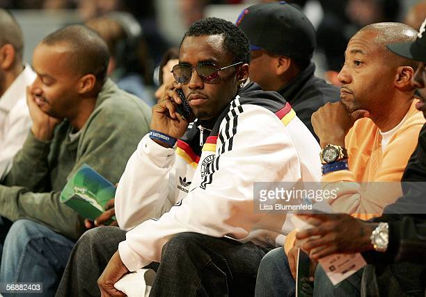 Sean Diddy Combs talks on his cell phone at the Sprite Rising Stars Slam Dunk competition during NBA AllStar Weekend at the Toyota Center on February...