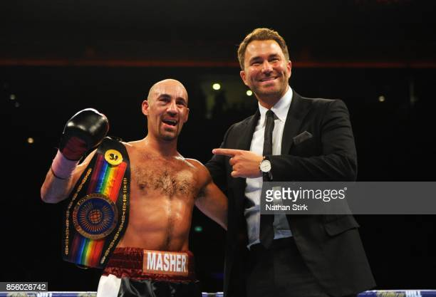 Sean Dodd Eddie Hearn pose for a photograph after the Battle on the Mersey Commonwealth Lightweight Championship fight at Echo Arena on September 30...