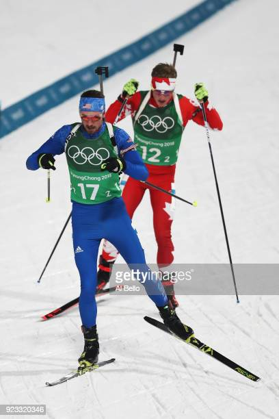 Sean Doherty of the United States competes with Scott Gow of Canada during the Men's 4x75km Biathlon Relay on day 14 of the PyeongChang 2018 Winter...