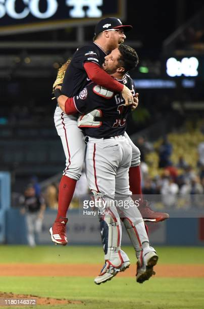 Sean Doolittle and catcher Yan Gomes of the Washington Nationals celebrate the final out of the tenth inning as the Nationals defeated the Los...