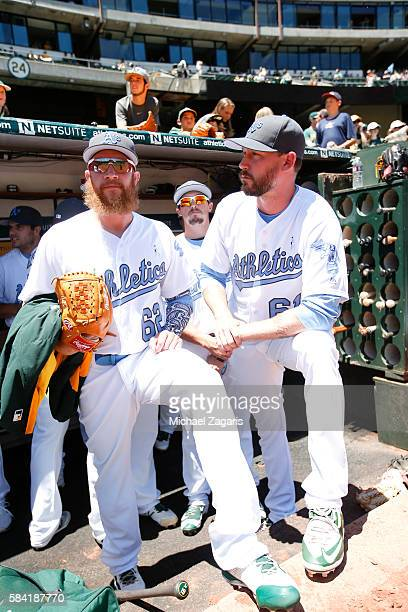 Sean Doolittle and John Axford of the Oakland Athletics stand in the dugout prior to the game against the Los Angeles Angels of Anaheim at the...