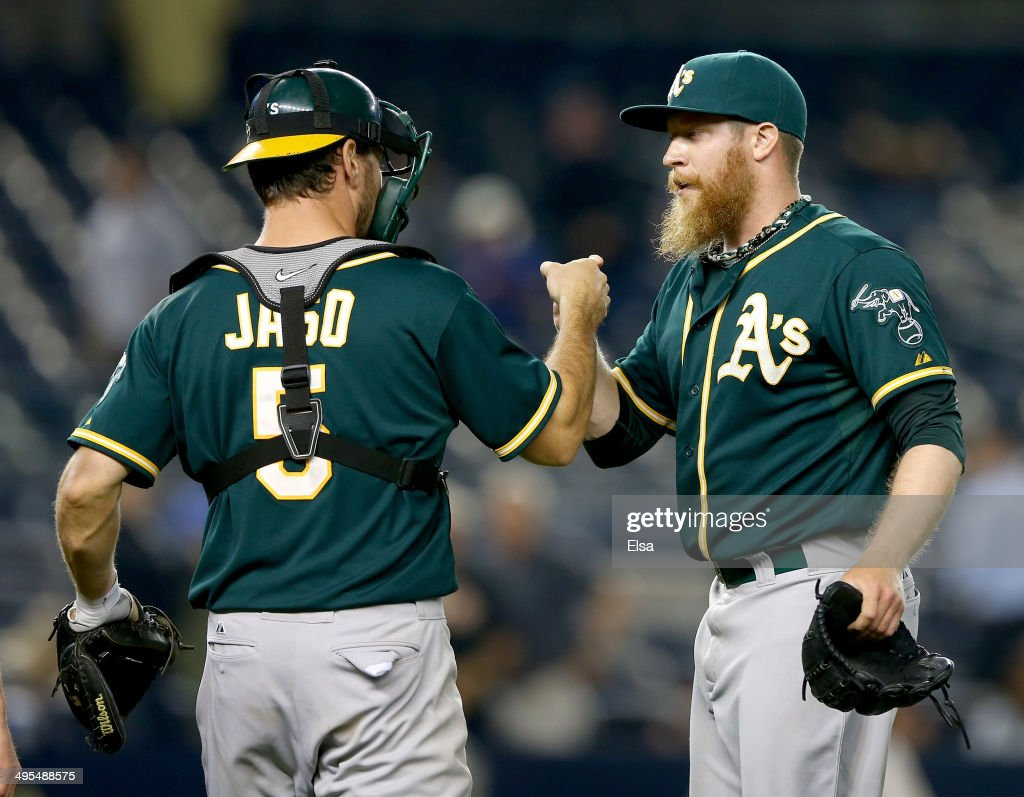 Sean Doolittle #62 of the Oakland Athletics celebrates the win with teammate John Jaso #5 after the game against the New York Yankees on June 3, 2014 at Yankee Stadium in the Bronx borough of New York City.The Oakland Athletics defeated the New York Yankees 5-2 in 10 innings.