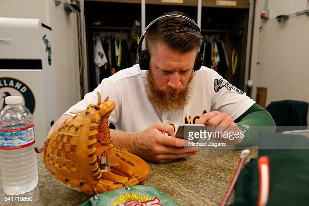 Sean Doolittle of the Oakland Athletics checks his iPhone in the clubhouse prior to the game against the Minnesota Twins at the Oakland Coliseum on...