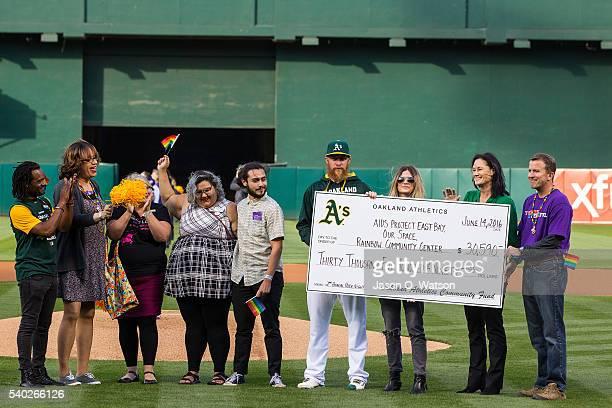 Sean Doolittle of the Oakland Athletics his girlfriend Eireann Dolan and University of San Francisco Women's basketball coach Jennifer Azzi present a...