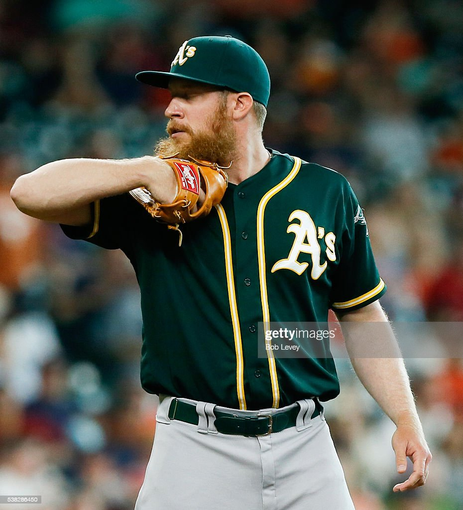 Sean Doolittle #62 of the Oakland Athletics looks in before his delivery in the seventh inning against the Houston Astros at Minute Maid Park on June 5, 2016 in Houston, Texas.