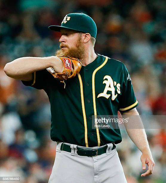 Sean Doolittle of the Oakland Athletics looks in before his delivery in the seventh inning against the Houston Astros at Minute Maid Park on June 5...