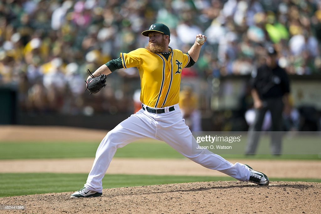 Sean Doolittle #62 of the Oakland Athletics pitches against the Baltimore Orioles during the ninth inning at O.co Coliseum on July 20, 2014 in Oakland, California. The Oakland Athletics defeated the Baltimore Orioles 10-2.