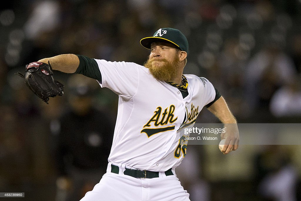 Sean Doolittle #62 of the Oakland Athletics pitches against the Tampa Bay Rays during the ninth inning at O.co Coliseum on August 5, 2014 in Oakland, California. The Oakland Athletics defeated the Tampa Bay Rays 3-0.